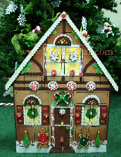 Large, ornate wood gingerbread house Advent calendar with pocket size compartments to count down the days until Christmas!